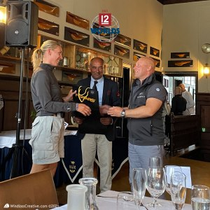 Jenetta (K-1) crew accepts 3rd place overall Daily prize from Mikael Stelander