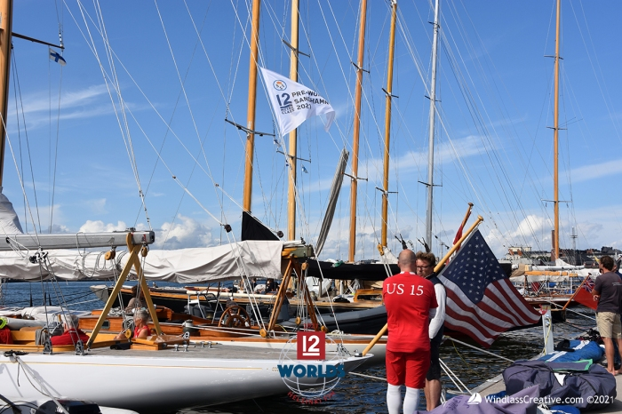 Although sailed by a Danish-German crew, Vim (US-15) flies the US flag in honor of her original sail number here on the dock at NJK for the 2021 EVLI 12mR World Championship ~ photo: SallyAnne Santos